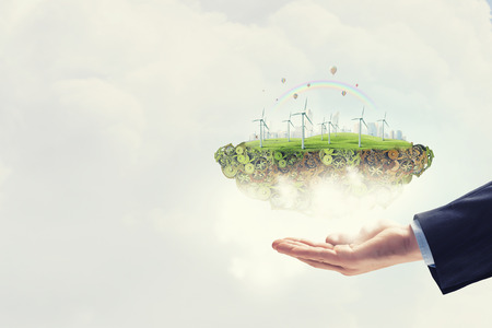 generators: Hands holding eco concept with windmill generators Stock Photo