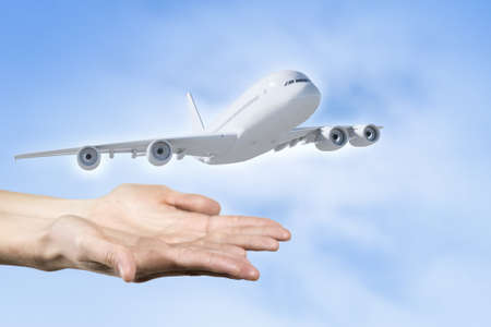 jet plane: Close up of male hand holding airplane model