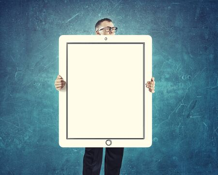 blank tablet: Young businessman holding white blank tablet banner