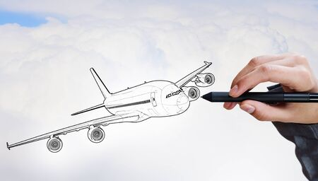aeroplane: Person drawing airplane model on sky background