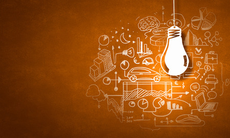 bright ideas: Concept of business ideas and strategy on color background