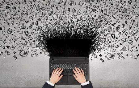 display advertising: Top view of businesswoman hands using black laptop