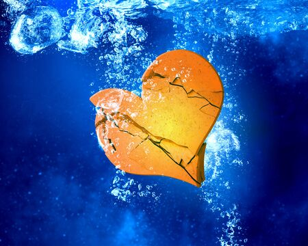 clear: Broken heart sinking and dissolving in clear blue water Stock Photo