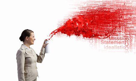speech cloud: Pretty businesswoman spraying red speech cloud from container Stock Photo