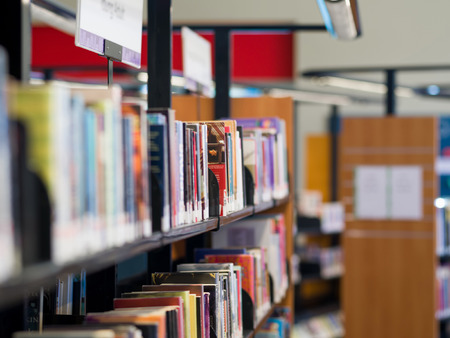 Interior of library with book shelves with books Stock Photo