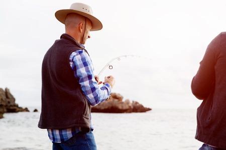 waders: Imagen de la pesca pescador con varillas Foto de archivo