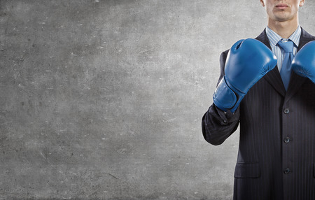 boxing glove: Determined businessman in suit and boxing gloves Stock Photo