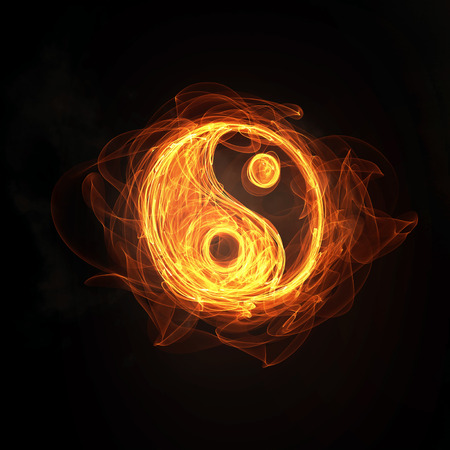 Glowing light Yin Yang sign in fire on dark background Фото со стока