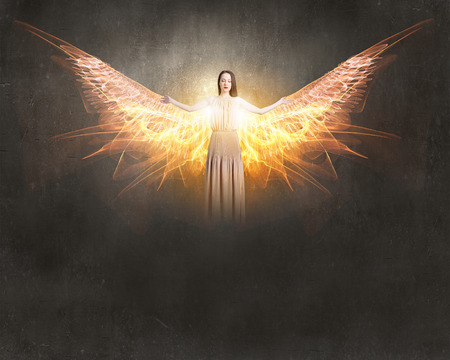attractive angels: Attractive woman with angel wings on sky background
