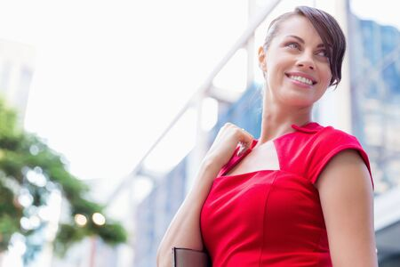 working dress: Portrait of beautiful business woman in red dress