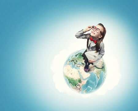 young schoolgirl: Wideangle picture of funny schoolgirl with paper plane. Elements of this image are furnished by NASA
