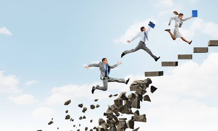 collapsing: Young businesspeople walking up collapsing staircase representing success concept Stock Photo
