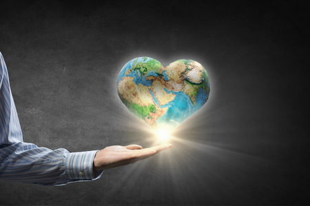 globe people: Businessman hands holding Earth planet.