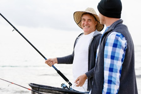 pecheur: Photo de pêcheurs qui pêchent avec des tiges