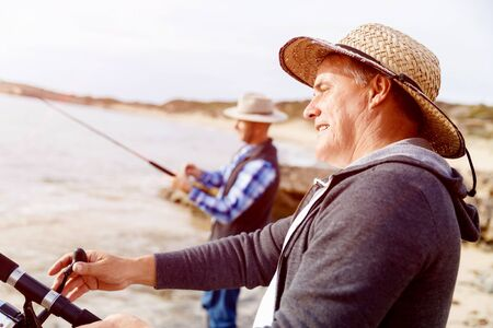 botas altas: Picture of fishermen fishing with rods