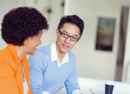 casual business man: Two desingers working on a project together in office Stock Photo