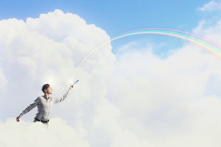 develope: Young handsome man on sky background reaching hand with book