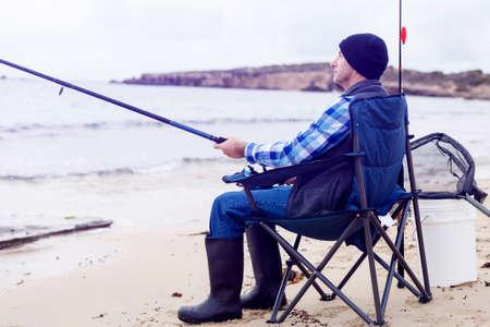 pescador: Imagen de la pesca pescador con varillas Foto de archivo