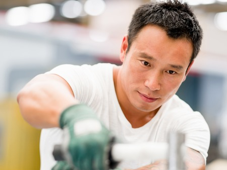 factory floor: portrait of asian worker in production plant working on the factory floor Stock Photo