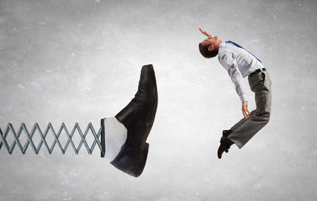 distress: Businessman kicked by his boss foot on spring