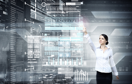 telecommute: Attractive businesswoman touching with finger virtual interface screen