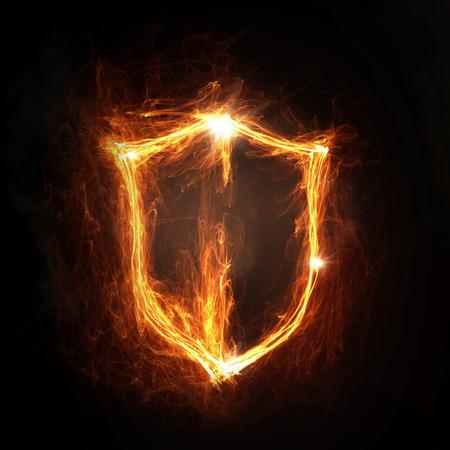 fire shield: Glowing fire shield icon on dark background