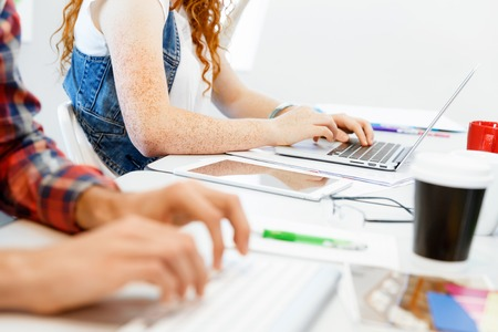 inputting: Hands of office worker typing on the keyboard Stock Photo