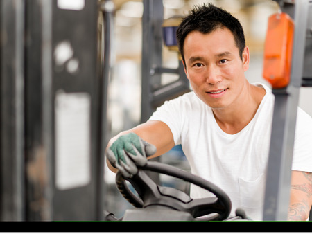 heavy equipment operator: portrait of asian worker in production plant working on the factory floor Stock Photo