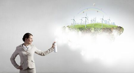 aerosol: Young businesswoman spraying eco concept from aerosol balloon Stock Photo