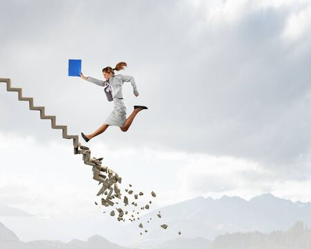 business challenge: Young businesswoman walking up collapsing staircase representing success concept