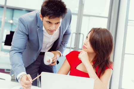 businessgroup: Two young business collegue working together in office Stock Photo