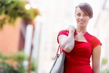 business life: Portrait of beautiful business woman in red dress