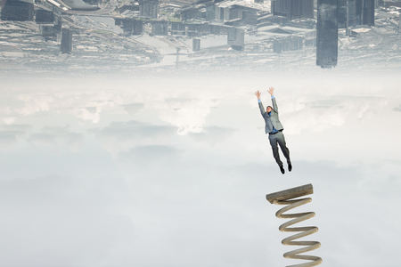 springboard: Businessman jumping on springboard as progress concept