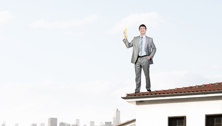 important phone call: Smiling businessman talking on yellow phone handset