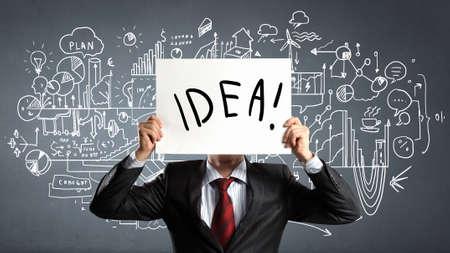 unknown men: Unrecognizable businessman holding paper sheet with idea concept