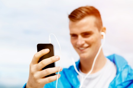mp3 player: Sports and music. man getting ready for jogging and listening to the MP3 player