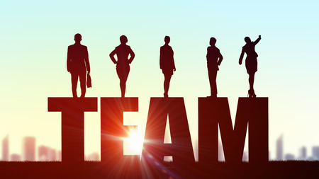collaboration: Business people standing on word team representing collaboration concept