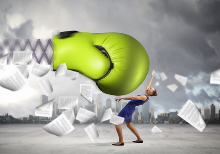 female boxing: Boxing glove on spring striking businesswoman down Stock Photo