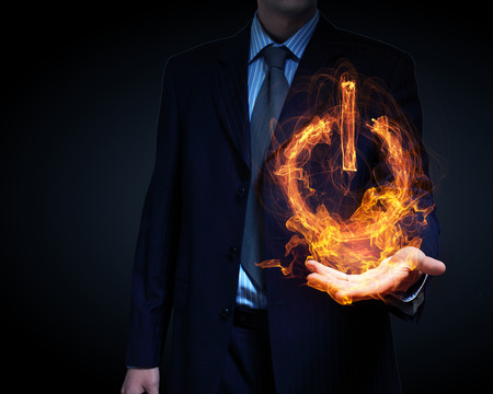power concept: Glowing fire power icon of interface on dark background Stock Photo