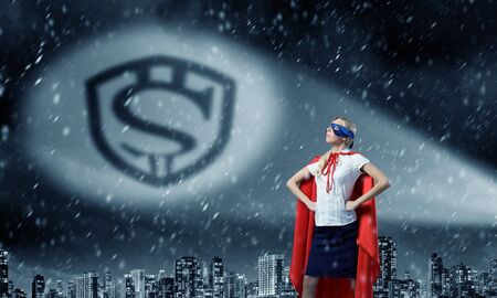 moneymaking: Young woman super hero and dollar sign in spotlight