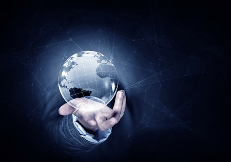 business globe: Man hand holding digital Earth planet representing global technologies concept