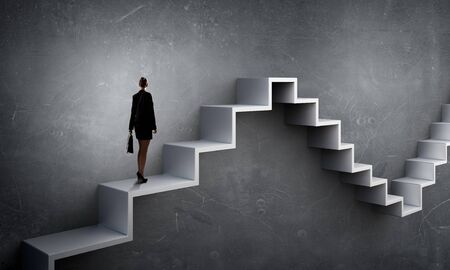 stepping stone: Businesswoman with suitcase stepping up stone staircase