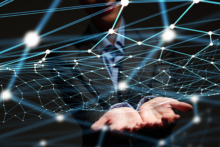 Businesswoman hand demonstrating digital connection lines in palm Stock Photo