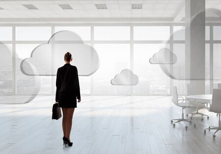 view of an elegant office: Elegant businesswoman in modern office interior against window panoramic view Stock Photo