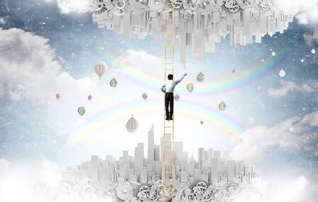 Businessman standing on ladder between two urban realities