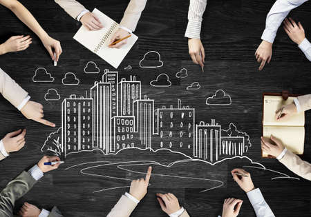bilding: Top view of people hands drawing teamwork strategy Stock Photo