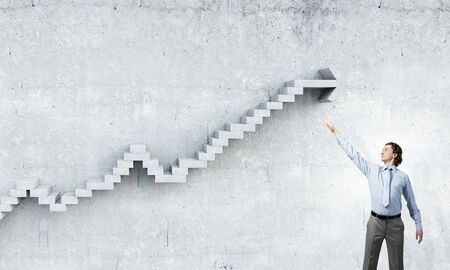 reaching hand: Businessman reaching hand to touch stone growing arrow graph