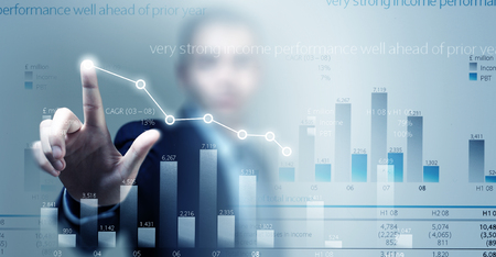 average guy: Close view of businessman touching screen with market infographs