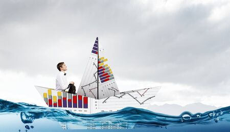 average guy: Successful businessman sailing on paper boat in financial sea