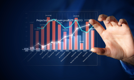 selling points: Close view of businessman touching screen with market infographs